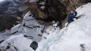 Man climbs frozen waterfall