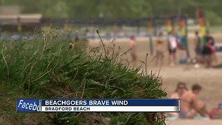 Beachgoers brave windy conditions at Bradford Beach