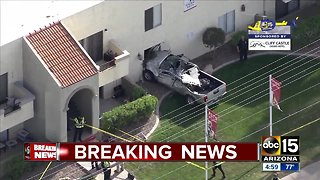 Truck crashes into building in Mesa