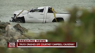 Truck crashes off Courtney Campbell Causeway
