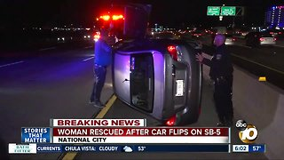 Woman rescued after car flips on SB-5 in National City