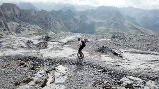 Alpso-lutely stunning! Daring unicyclist shows no fear riding through mountains