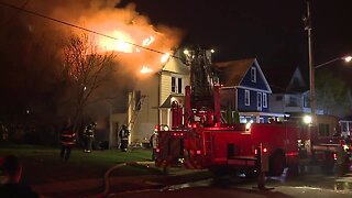 Cleveland firefighters battle house fire early Friday morning