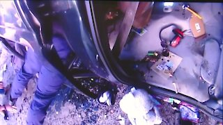 Bodycam shows Twinsburg police officers rescue trapped children from overturned vehicle