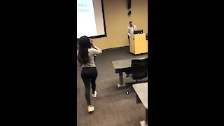 Students surprise professor with cake & card