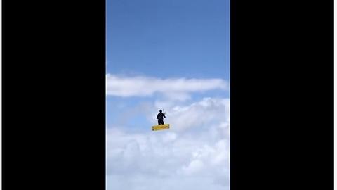 Kitesurfer makes insanely huge jump on windy day