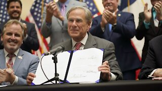 Texas Governor Signs Controversial Voting Bill Into Law