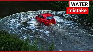 Two men trapped after driving into flood