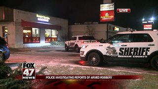 Police investigating armed robbery at Hungry Howie's Pizza