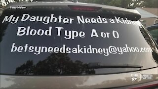 Woman making decals to help others find living donors