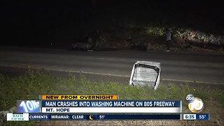 Car slams into washing machine on freeway