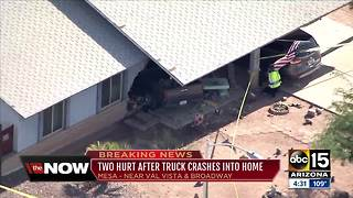 Two hurt after truck crashes into Mesa house