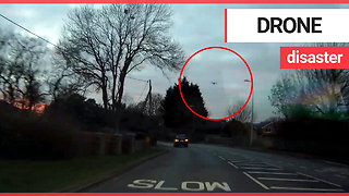 Out of control drone falls from sky - almost crashing into oncoming car