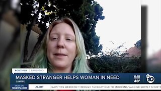 Masked stranger helps woman in need
