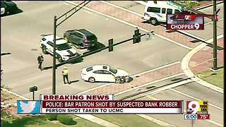 Police: Bar patron shot by bank robbery suspect
