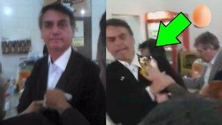 Video shows protester breaking egg on President Bolsonaro