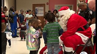 Santa delivers gifts to critically ill children