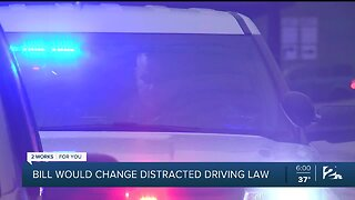 Bill would change distracted driving law