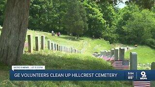 GE volunteers clean up cemetery