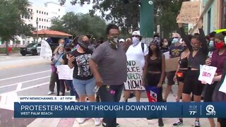 Protesters march through downtown West Palm Beach