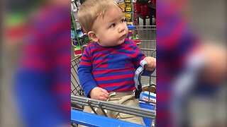 Baby is Mesmorized by Singing Christmas Decoration
