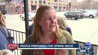 People preparing for spring snow