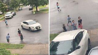 Neighbourhood kids celebrate man coming home so they can play kickball