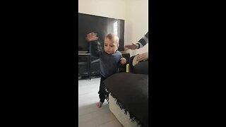 Baby boy dances to dad's drum solo