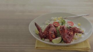 Wings with Annatto and Red Chile on Rice with Vegetables