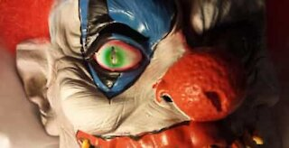 Son scares dad with clown mask
