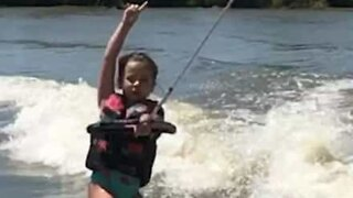 Young girl dances while wakeboarding!