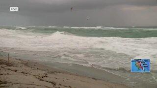 Kitesurfers ride the waves in Juno Beach