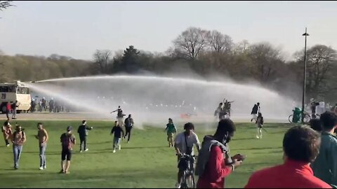 COVID NIGHTMARE: Belgian Police Use WATER CANNONS to Stop People from Gathering in Park