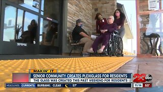Senior community creates plexiglass for residents to visit with families