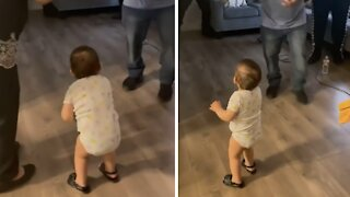 Baby busts out some hilariously epic dance moves