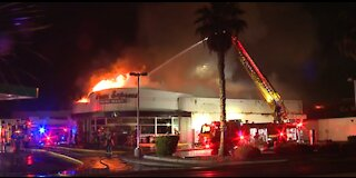 Las Vegas firefighters battle fire at mini-mart on Monday