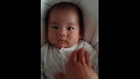 Adorable 6-week-old infant smiles for camera