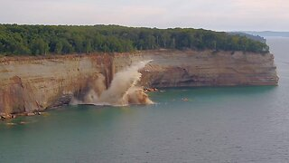 TERRIFYING MOMENT MASSIVE CLIFF FALLS CLOSE TO KAYAKERS