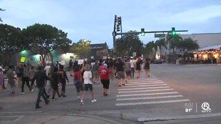 Lake Worth Beach vigil sends message of unity amidst unrest