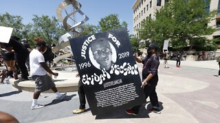 Officers Investigated After Taking Photos At Elijah McClain Memorial