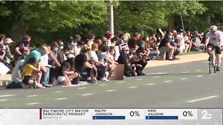 A community comes together in Roland Park to form a peaceful protest