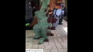 Dance party consists of people dressed up in dinosaur costumes