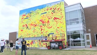 Collaborative effort among artists brings new mural to buffalo