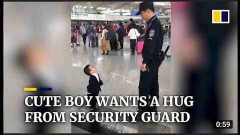 Cute boy wants a big from security guard