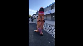 Dude in Glasgow wears T-Rex costume for safety measures