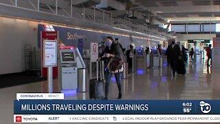 Millions of Americans traveling despite pandemic warnings