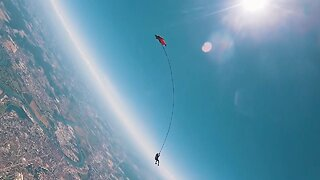 DAREDEVILS PERFORM WORLD'S FIRST BUNGEE JUMP WHILE TIED TO A WINGSUIT PILOT