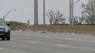 Hundreds of face masks found scattered along I-90 between West 140th Street and Warren Road