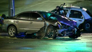 Vehicle blows through red light, crashes with police squad