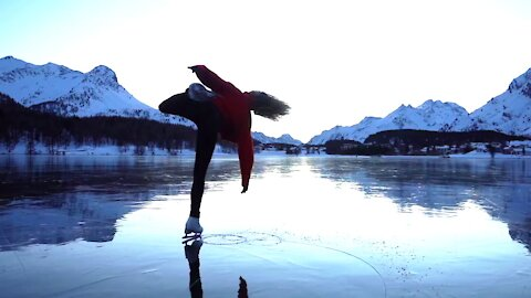Girl Performs Amazing Ice Skating Act Amidst Mountains In Switzerland